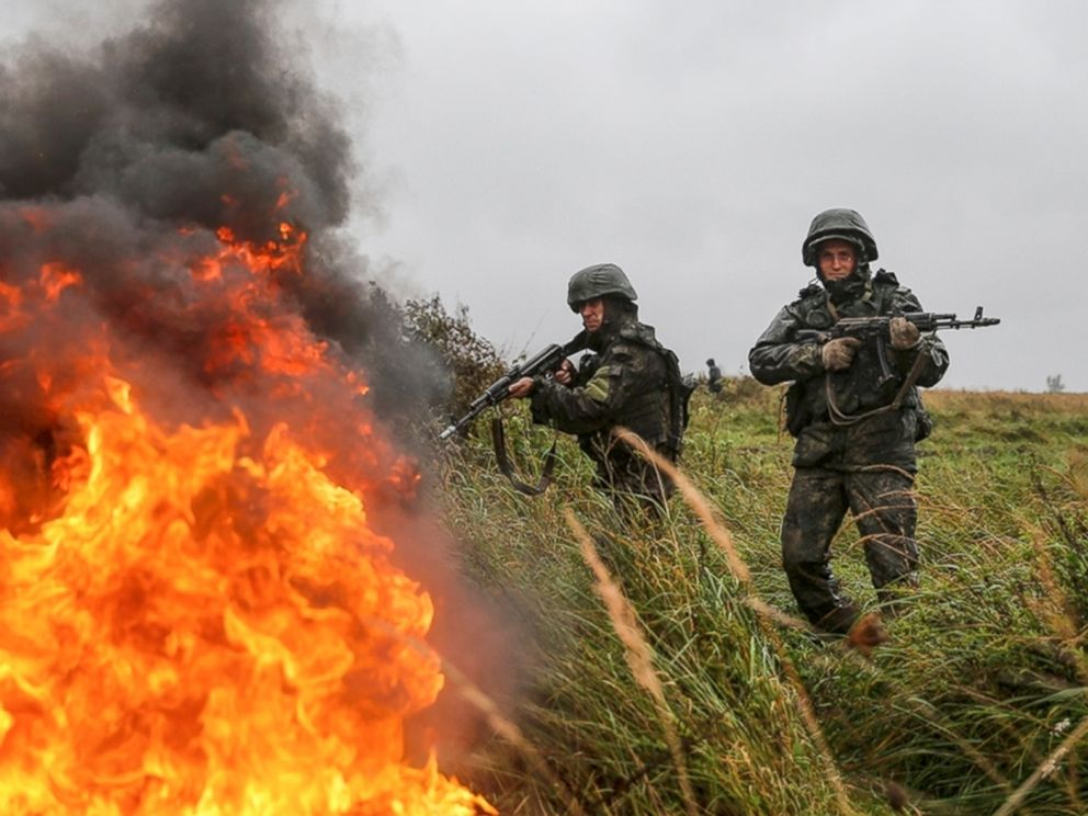 Putin displays massive firepower in Russian war games on border with Europe